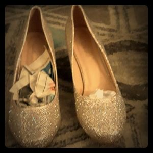 Silver and tan heels